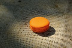 French macaroons orange tasty snacks. Stock Photography