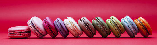 French macaroons. On red background Royalty Free Stock Photos