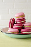 French macaroons on retro plate. Closeup Royalty Free Stock Photography