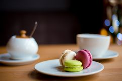 French macaroons on wooden table royalty free stock photos