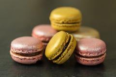 French macrarons on dark background. Tasty macarons on dark background stock photography