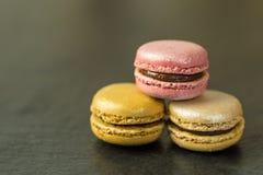 French macrarons on dark background. Tasty macarons on dark background stock photo