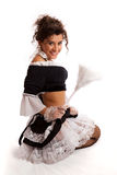 French maid posing with feather duster Stock Images