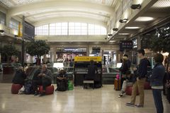 French man playing piano for show French people  and foreigner travlers at Gare de Paris-Est or Paris Gare de l`est. Railway station on September 7, 2017 in Royalty Free Stock Photos