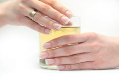 French manicure. On hands with a cup expecting Royalty Free Stock Photography