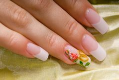 French manicure. Close-up French manicure for a wedding gold fabric Stock Photo