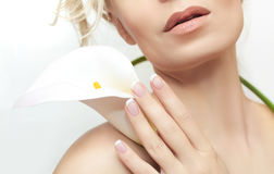French manicure. The classic French manicure on female hand with a white flower stock images