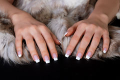 French manicure and furs royalty free stock images