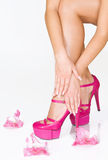 French manicure, high heels and pink flowers Stock Photos