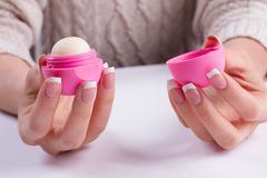 French manicure with lip gloss. Stock Photography
