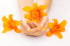 French manicure with orange lily. spa Stock Images