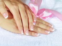 French manicure with pink and red hearts on the Stock Images