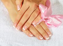 French manicure with pink and red hearts on the Royalty Free Stock Photo