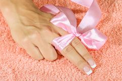 French manicure with pink and red hearts on the Royalty Free Stock Images