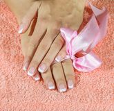 French manicure with pink and red hearts on the Royalty Free Stock Image