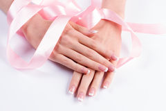 French manicure with pink ribbon. Royalty Free Stock Image
