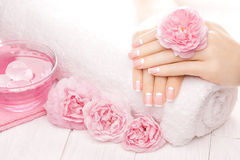 French manicure with rose flowers. spa Royalty Free Stock Image