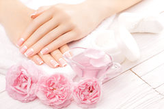 French manicure with rose flowers. spa Royalty Free Stock Photography