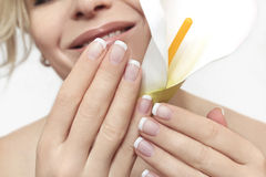 French manicure. Short French manicure on hands of a young woman royalty free stock photo