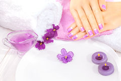 French manicure with violet flowers. spa Stock Photo