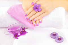 French manicure with violet flowers. spa Stock Images