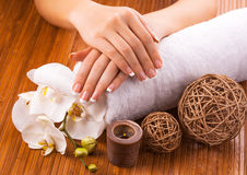 French manicure with white orchid  on a bamboo Stock Photo