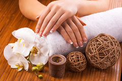 French manicure with white orchid  on a bamboo Royalty Free Stock Photo