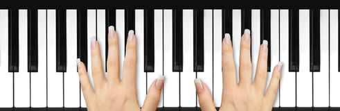 French manicured nails on keyboard. Two female hands with French manicured nails on piano keyboard Stock Image