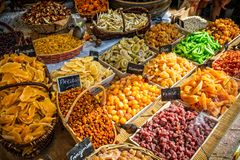 French market stall with colourful dried fruit. Selection of colourful dried fruit on French market stall royalty free stock photography