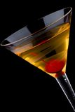 French martini - Most popular cocktails series. French martini in chilled glass over black background on reflection surface, garnished with maraschino cherry royalty free stock photo