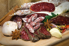 French meat assorted. French meat with salami on wooden table royalty free stock photos