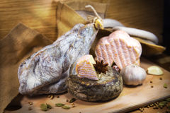 French meat with cheeses and garlic. French meat with cheeses on wooden table stock photos