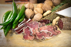 French meat with green chili. French meat sliced with green chili stock photos
