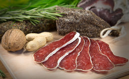 French meat sliced on wood. French meat sliced with peanuts royalty free stock image