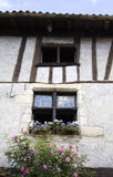 French Medieval House. A French medieval half-timbered house decorated with flowers Royalty Free Stock Photo