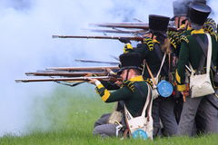 French medieval soldiers shooting rifles Stock Photography