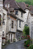 French Medieval Street. A street winds past medieval stone buildings in Saint-Cirq Lapopie, France Royalty Free Stock Photos