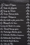 French Menu On Blackboard. A typical cafe menu written on chalk on a blackboard as seen in the twon of Beaune in France Royalty Free Stock Images