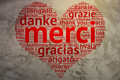 French: Merci, Heart shaped word cloud Thanks, Grunge Background Royalty Free Stock Image