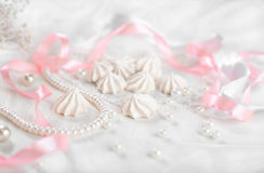 French meringue cookies for wedding background with pearls, pink and white satin ribbons and lace Royalty Free Stock Images