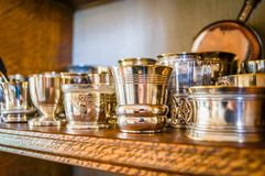 French metal eggcups. On a shelf with bronze and silver eggcups Royalty Free Stock Images
