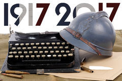 French military helmet of the First World War with old typewrite Royalty Free Stock Images