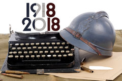 French military helmet of the First World War with old typewrite. A french military helmet of the First World War with old typewriter Royalty Free Stock Photos