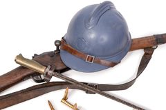 French military helmet of the First World War with rifle on whit. French military helmet of the First World War with rifle isolated on white background royalty free stock photo