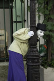 French Mime Peeking Around Lampost Royalty Free Stock Photo