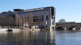 French Ministry for the Economy and Finance and Bercy bridge - Paris. French Ministry for the Economy and Finance with Metro crossing Bercy bridge in background stock video footage