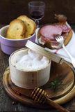 French Mont D'or cheese and red wine Royalty Free Stock Photography