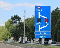 French motorway and indications to  Paris in France. The french text Peage means toll payment in french linguage stock photo