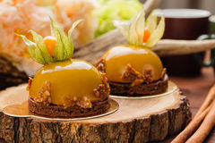 French mousse cake covered with caramel glaze Stock Photography