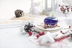 French mousse cake covered with violet glaze Royalty Free Stock Image